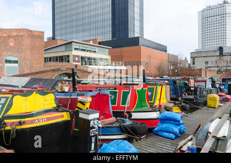 Colourful painted narrow boats on the canal in Gas Street Basin in Birmingham - Stock Photo