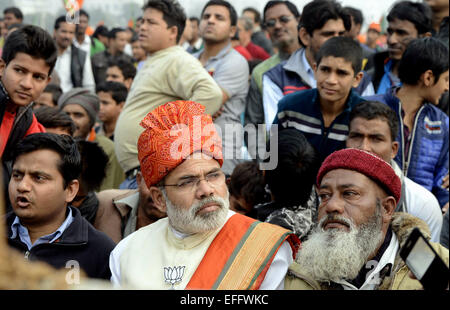 New Delhi, India. 3rd Feb, 2015. A Bharatiya Janata Party (BJP) supporter (C, front) dresses as the leader and Indian - Stock Photo