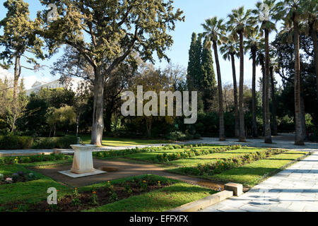 The National Gardens, Athens , Greece. With the Greek Parliament building in the distance. - Stock Photo