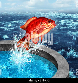Courage concept and ambition symbol as a red fish jumping out of an artificial pool to join the natural blue ocean - Stock Photo