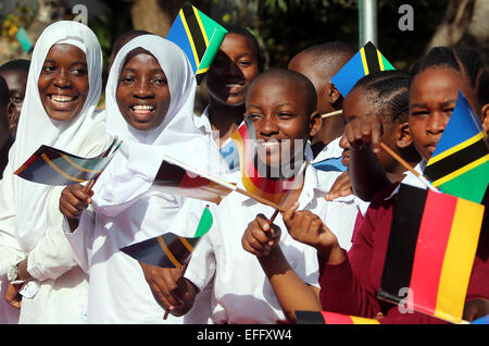 Young people greet German President Gauck with flags in Dar es Salaam, Tanzania, 03 February 2015. The German President - Stock Photo