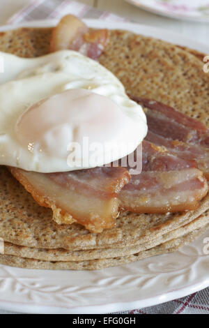 Staffordshire Oatcakes a savoury pancake with bacon and egg - Stock Photo
