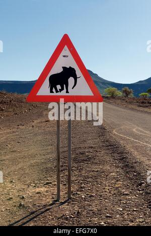 Beware Elephants.  A road sign indicating the possible presence of Elephants on the road ahead in Namibia, Africa. - Stock Photo