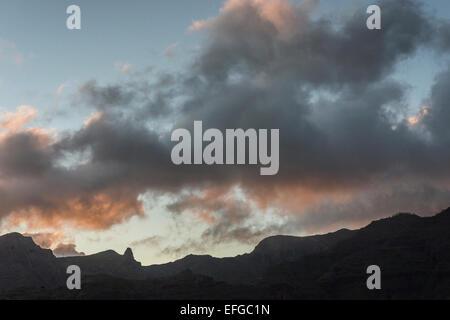 Evening sky clouds lit by sun set La Gomera Canary Islands - Stock Photo
