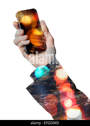 Hand holding a smart phone with city lights - Stock Photo