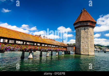Lucerne, Switzerland. Chapel Bridge and Water Tower is a covered wooden footbridge across the Reuss River in city - Stock Photo