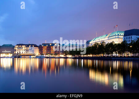 View across the Inner Alster towards representative office buildings, hotels, and commercial buildings on Jungfernstieg - Stock Photo