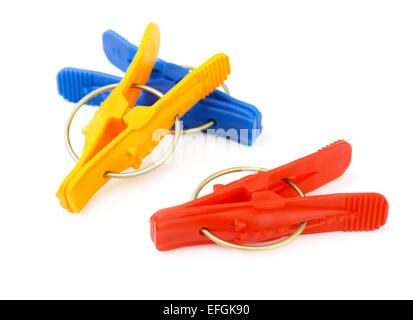 Plastic clothes pegs isolated on white - Stock Photo