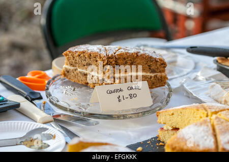 Food fair cake stall selling home made cakes. Close up of carrot cake for sale by the slice. - Stock Photo
