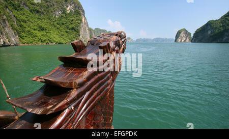 Front of a Vietnamese junk boat sailing through Halong Bay, Vietnam - Stock Photo
