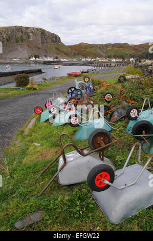 The wheelbarrows locals used to carry items from the ferry to their houses on Easdale, due to no cars on the island - Stock Photo