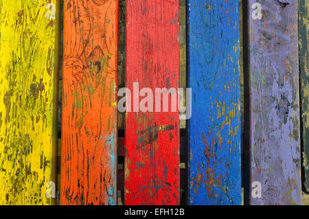 Chipped paint wood texture colorful planks weathered wooden boards abstract background. - Stock Photo