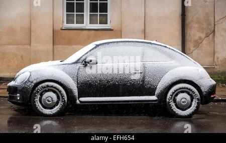 A New Beetle covered in snow, Copenhagen, Denmark - Stock Photo