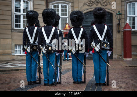 Royal Life Guards in front of Amalienborg Palace when it is snowing, Copenhagen, Denmark - Stock Photo