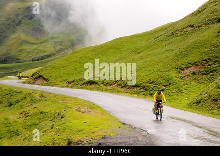 Two cyclists on Col d'Aubisque (1709m), Pyrenees (France). - Stock Photo