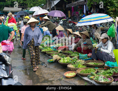 HOI AN, VIETNAM - October 17th, 2014. Fruits and vegetables vendors selling products at Hoi An market in Hoi An - Stock Photo