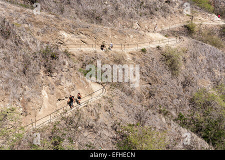 The Long Dry Walk to the Top. Hikers trek up and down the narrow winding path to the summit of Diamond Head - Stock Photo