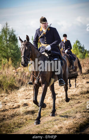 The field master and a lady rider taking part in a deer hunting with hounds in the Landes region (France). - Stock Photo