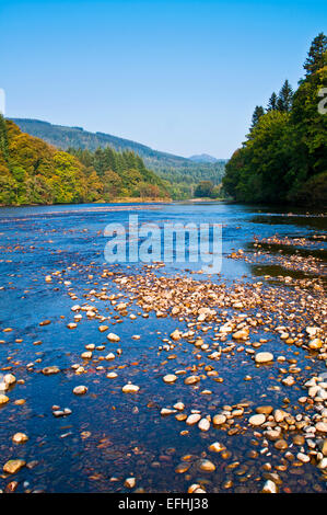 River Tay at Dunkeld, calm sunny autumn day, low water, stones exposed on river bed, Perth and Kinross, Highlands, - Stock Photo