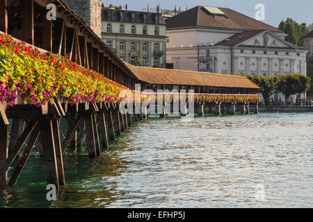 Kapellbrucke, famous wooden footbridge in Lucerne, Switzerland. - Stock Photo