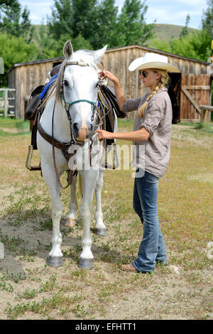Cowgirl and horse, La Reata Ranch, Saskatchewan, Canada. - Stock Photo