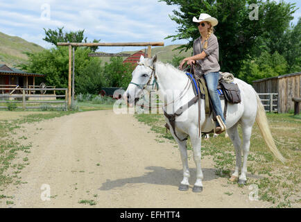 Girl on horseback, La Reata Ranch, Saskatchewan, Canada. - Stock Photo