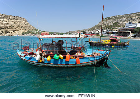 Fishing boat in the bay of Matala, a village on the south coast of the greek island Crete, Mediterranean Sea, Greece - Stock Photo