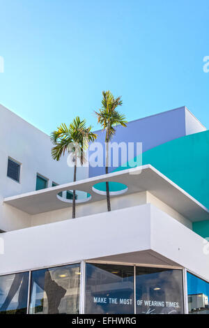 Modern architecture with palm trees on Collins Avenue, Art Deco District, South Beach, Miami, Florida, USA - Stock Photo