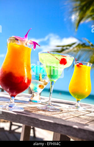 Table with tropical fruit cocktails, Little Palm Island Resort, Florida Keys, USA - Stock Photo
