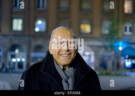 Smiling elderly man 80s portrait at night - Stock Photo