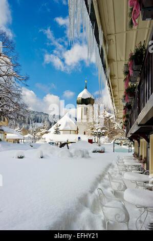 Hotel Adler and church, Hinterzarten, Black Forest, Baden-Wuerttemberg, Germany - Stock Photo