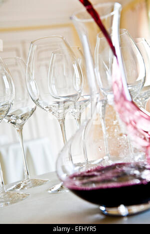 Red wine being poured into a decanter, Red wine glasses, Hamburg, Northern Germany, Germany - Stock Photo