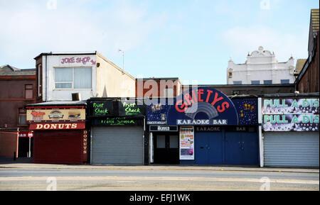 Blackpool Lancashire UK - karaoke Bar , Shops and stalls closed up for winter - Stock Photo