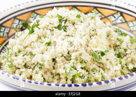 cauliflower prepared as couscous  with chopped parsley, za'atar,  and preserved lemons - Stock Photo