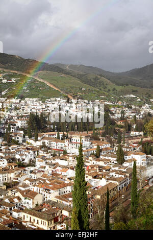 View of Granada after rain with rainbow, Spain - Stock Photo