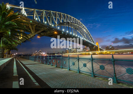 SYDNEY, AUSTRALIA- JANUARY 5, 2015: The iconic Sydney Harbour Bridge with Sydney Opera House in the background at - Stock Photo