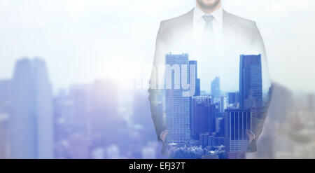 close up of businessman over city background - Stock Photo