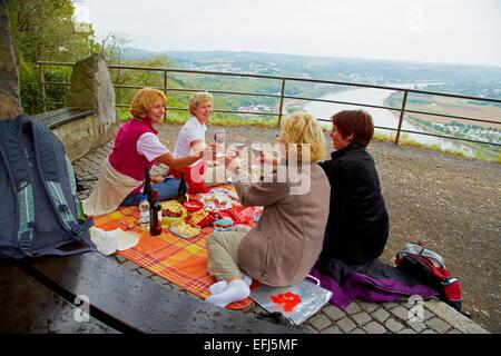 Women having a picnic on top of the Erpeler Ley, Erpel, Rhine, Rhineland-Palatinate, Germany, Europe - Stock Photo