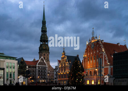 Town Hall Square and the House of Blackheads with St. Peter's Basilica with the Christmas tree for the New Year - Stock Photo