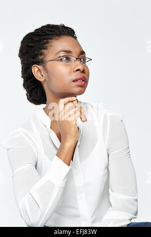 Ethnic woman working out finances - Stock Photo