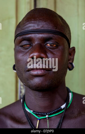 Portrait Of A Man From The Mursi Tribe, Jinka, Omo Valley, Ethiopia - Stock Photo