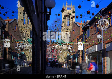 Christmas shoppers in Coppergate, York, North Yorkshire, England, UK - Stock Photo