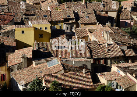 View over Tiled Terracotta Rooftops of Moustiers or Moustiers-Sainte-Marie Alpes-de-Haute-Provence Provence France - Stock Photo