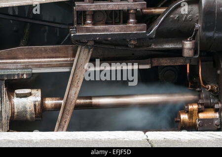 Complexity of rods, pistons and valves that form part of the driving mechanism of a steam loco - Stock Photo