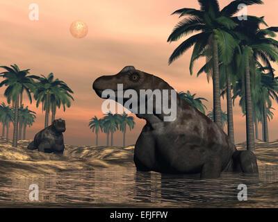 Keratocephalus dinosaurs in a small lake at sunset. - Stock Photo