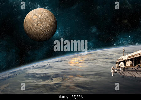 A team of astronauts work on a space station in orbit. An Earth-like planet sees the glow of a nearby sun while - Stock Photo