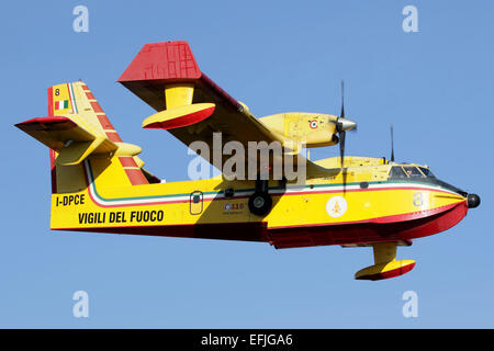 A CL-415 Italian Fire Hunter flying above Lago di Viverone in northern Italy. - Stock Photo