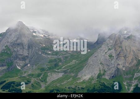 View from Col d'Aubisque (1709m) towards Pic de la Latte de Bazen, Pyrenees (France) on a foggy day. - Stock Photo