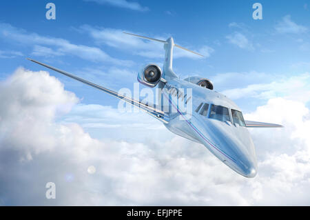 Private Jet airplane flying. Perspective/front view. With sky and clouds background. - Stock Photo