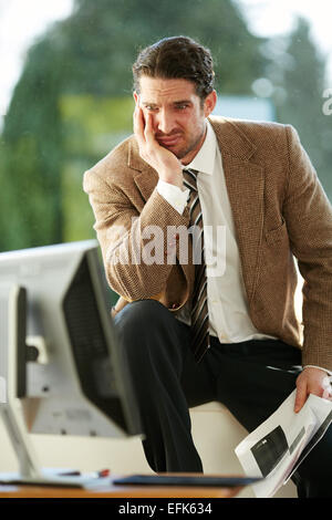 Man stressed out at work - Stock Photo